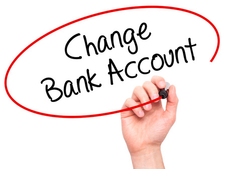 e banking: Man Hand writing Change Bank Account with black marker on visual screen. Isolated on background. Business, technology, internet concept. Stock Photo