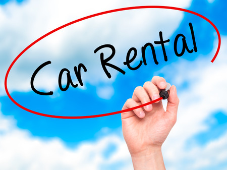 rental: Man Hand writing Car Rental with black marker on visual screen. Isolated on sky. Business, technology, internet concept. Stock Photo Stock Photo