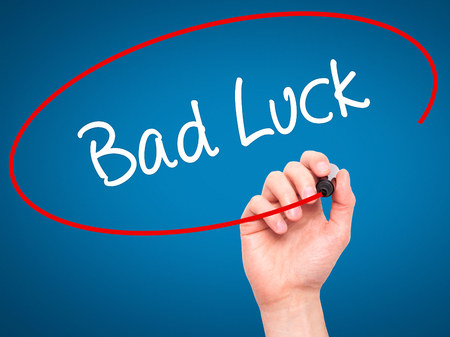bad luck: Man Hand writing Bad Luck with black marker on visual screen. Isolated on background. Business, technology, internet concept. Stock Photo