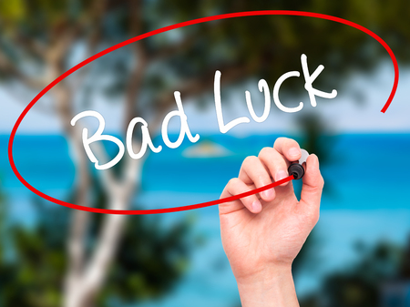 Man Hand writing Bad Luck with black marker on visual screen. Isolated on background. Business, technology, internet concept. Stock Photo