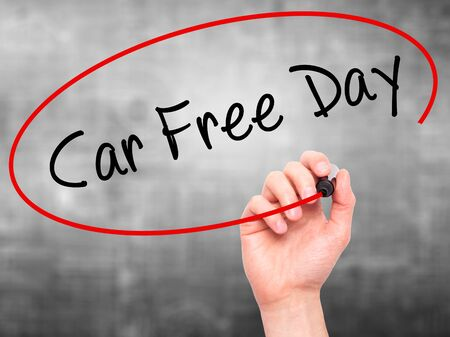 writing on screen: Man Hand writing Car Free Day with black marker on visual screen. Isolated on background. Business, technology, internet concept. Stock Photo Stock Photo