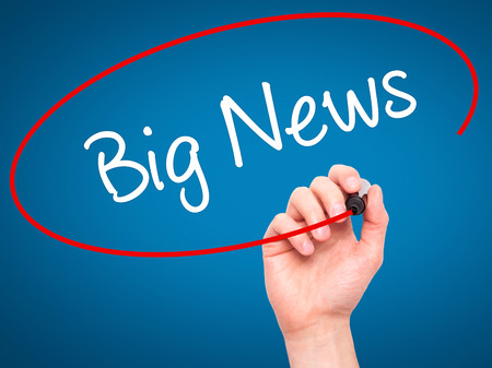 annoucement: Man Hand writing Big News with black marker on visual screen. Isolated on blue. Business, technology, internet concept. Stock Photo