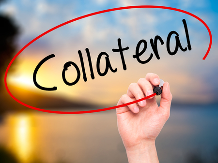 collateral: Man Hand writing Collateral with black marker on visual screen. Isolated on nature. Business, technology, internet concept. Stock Photo