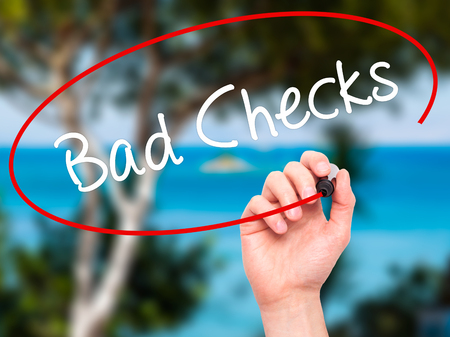 cheated: Man Hand writing Bad Checks with black marker on visual screen. Isolated on background. Business, technology, internet concept. Stock Photo Stock Photo