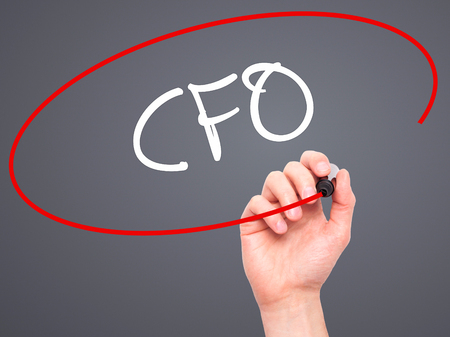 financial controller: Man Hand writing CFO (Chief Financial Officer) with black marker on visual screen. Isolated on background. Business, technology, internet concept. Stock Photo