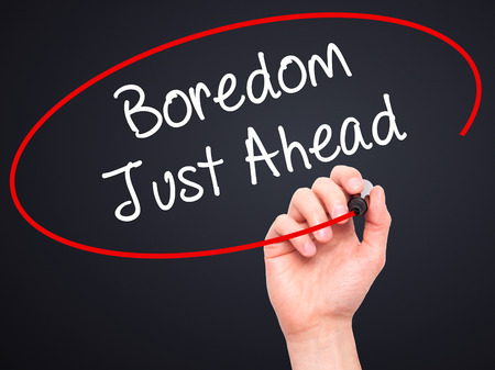 disinterested: Man Hand writing Boredom Just Ahead with black marker on visual screen. Isolated on background. Business, technology, internet concept. Stock Photo Stock Photo