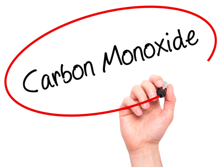 poisonous substances: Man Hand writing Carbon Monoxide  with black marker on visual screen. Isolated on white. Business, technology, internet concept. Stock Photo