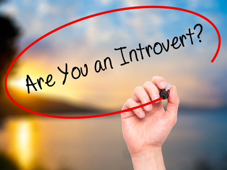 outspoken: Man Hand writing Are You an Introvert? with black marker on visual screen. Isolated on nature. Business, technology, internet concept. Stock Photo Stock Photo