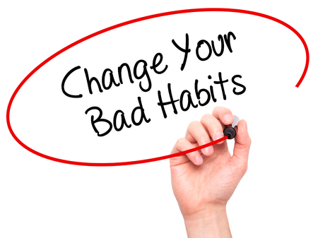 bad planning: Man Hand writing Change Your Bad Habits  with black marker on visual screen. Isolated on white. Business, technology, internet concept. Stock Photo Stock Photo