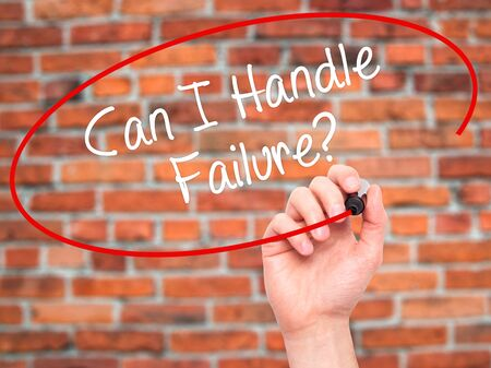 loss leader: Man Hand writing Can I Handle Failure? with black marker on visual screen. Isolated on bricks. Business, technology, internet concept. Stock Photo