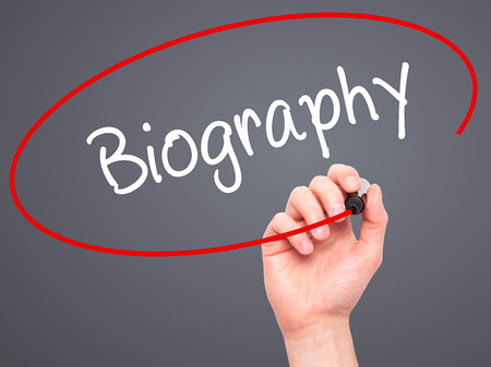 unveil: Man Hand writing Biography  with black marker on visual screen. Isolated on grey. Business, technology, internet concept. Stock Photo