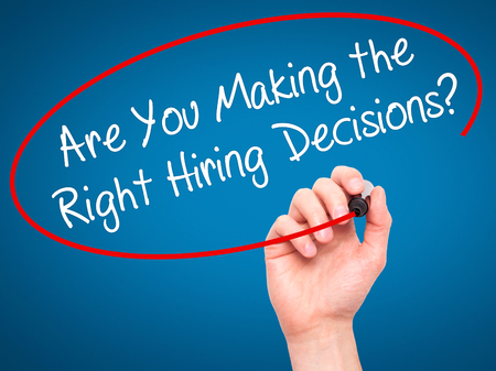 Man Hand writing Are You Making the Right Hiring Decisions? with black marker on visual screen. Isolated on background. Business, technology, internet concept. Stock Photo