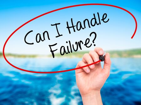 loss leader: Man Hand writing Can I Handle Failure? with black marker on visual screen. Isolated on nature. Business, technology, internet concept. Stock Photo Stock Photo