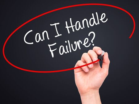 loss leader: Man Hand writing Can I Handle Failure? with black marker on visual screen. Isolated on black. Business, technology, internet concept. Stock Photo