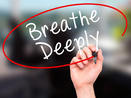deeply: Man Hand writing Breathe Deeply with black marker on visual screen. Isolated on office. Business, technology, internet concept. Stock Photo