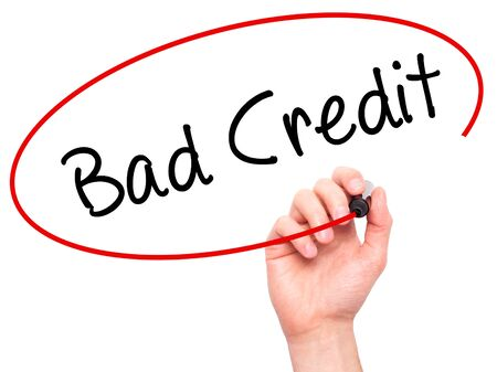 creditworthiness: Man Hand writing Bad Credit with black marker on visual screen. Isolated on white. Business, technology, internet concept. Stock Photo Stock Photo