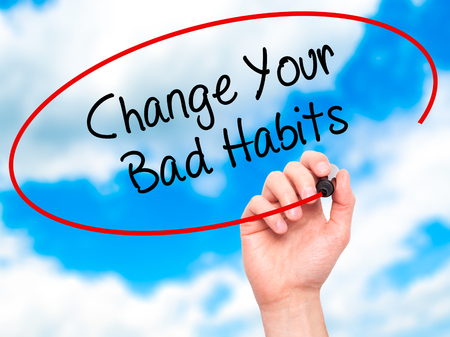 bad planning: Man Hand writing Change Your Bad Habits  with black marker on visual screen. Isolated on sky. Business, technology, internet concept. Stock Photo