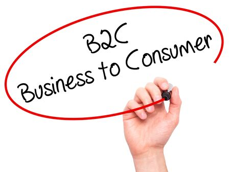 b2c: Man Hand writing B2C Business to Consumer with black marker on visual screen. Isolated on background. Business, technology, internet concept. Stock Photo