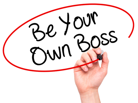 self starter: Man Hand writing Be Your Own Boss with black marker on visual screen. Isolated on white. Business, technology, internet concept. Stock Image