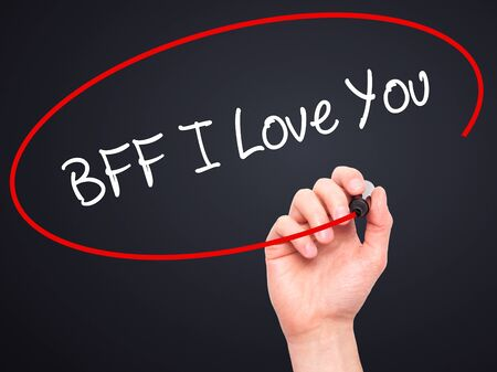 nota: Man Hand writing BFF I Love You with black marker on visual screen. Isolated on black. Business, technology, internet concept.