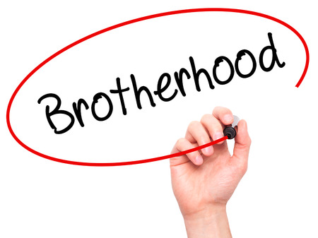 fraternidad: Man Hand writing  Brotherhood  with black marker on visual screen. Isolated on background. Business, technology, internet concept. Stock Photo