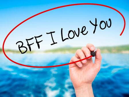bff: Man Hand writing BFF I Love You with black marker on visual screen. Isolated on nature. Business, technology, internet concept.