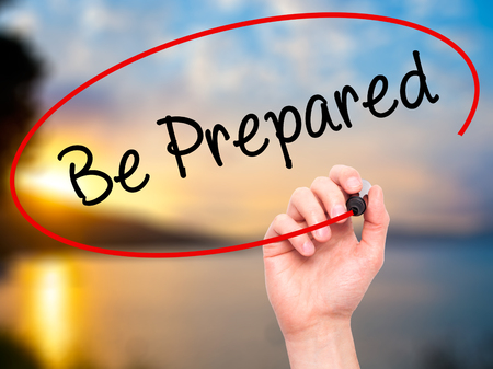 be prepared: Man Hand writing Be Prepared with black marker on visual screen. Isolated on nature. Business, technology, internet concept. Stock Photo