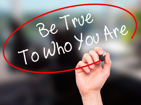 true self: Man Hand writing Be True To Who You Are with black marker on visual screen. Isolated on office. Business, technology, internet concept. Stock Photo Stock Photo