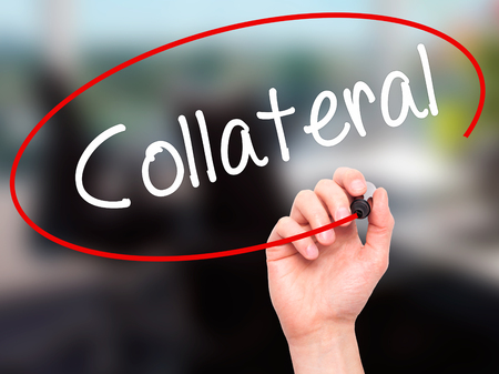 collateral: Man Hand writing Collateral with black marker on visual screen. Isolated on office. Business, technology, internet concept. Stock Photo Stock Photo