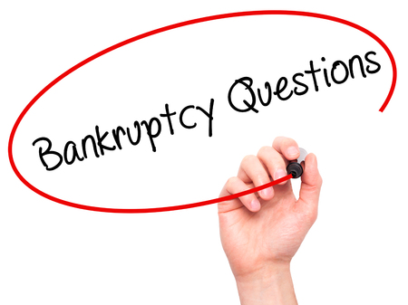 portable failure: Man Hand writing Bankruptcy Questions with black marker on visual screen. Isolated on white. Business, technology, internet concept. Stock Photo