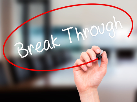 self discovery: Man Hand writing Break Through with black marker on visual screen. Isolated on office. Business, technology, internet concept. Stock Photo Stock Photo