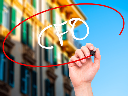 comit� d entreprise: Man Hand writing CFO (Chief Financial Officer) with black marker on visual screen. Isolated on background. Business, technology, internet concept. Stock Photo
