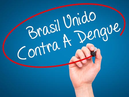 contra: Man Hand writing Brasil Unido  Contra A Dengue (Brazil against Dengue in Portuguese) with black marker on visual screen. Isolated on blue. Business, technology, internet concept. Stock Photo