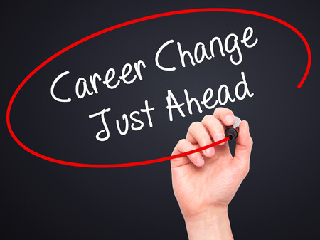 just ahead: Man Hand writing Career Change Just Ahead with black marker on visual screen. Isolated on black. Business, technology, internet concept. Stock Photo