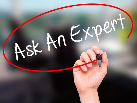 warranty questions: Man Hand writing Ask An Expert with black marker on visual screen. Isolated on office. Business, technology, internet concept. Stock Photo