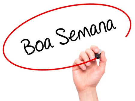 black boa: Man Hand writing Boa semana   (Good WeekIn portuguese)with black marker on visual screen. Isolated on white. Business, technology, internet concept. Stock Photo Stock Photo