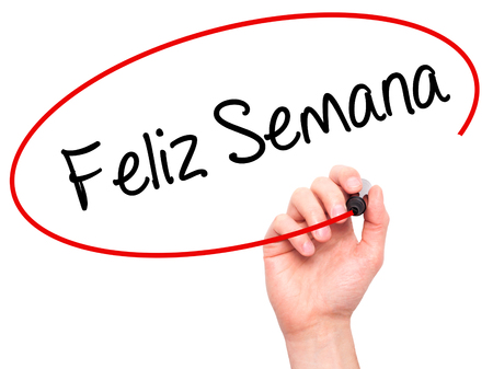 semana: Man Hand writing Feliz Semana  (Happy Week in SpanishPortuguese) with black marker on visual screen. Isolated on background. Business, technology, internet concept. Stock Photo