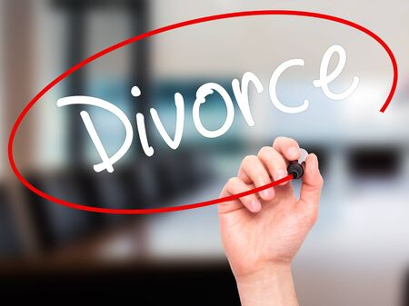 ex wife: Man Hand writing Divorce  with black marker on visual screen. Isolated on office. Business, technology, internet concept. Stock Photo Stock Photo