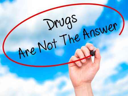 health answers: Man Hand writing Drugs Are Not The Answer with black marker on visual screen. Isolated on sky. Business, technology, internet concept. Stock Photo Stock Photo