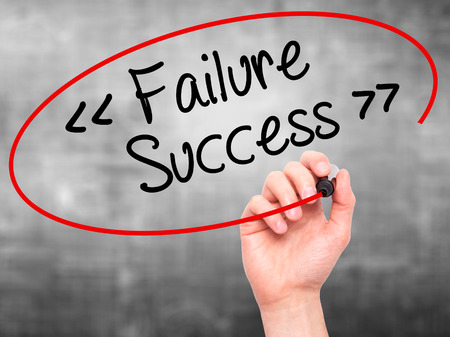 opt: Man Hand writing Failure Success with black marker on visual screen. Isolated on background. Business, technology, internet concept. Stock Photo