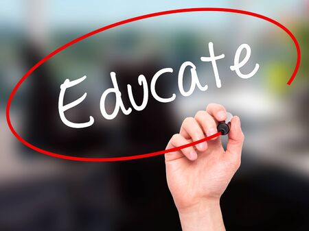 knowhow: Man Hand writing Educate with black marker on visual screen. Isolated on background. Business, technology, internet concept. Stock Photo