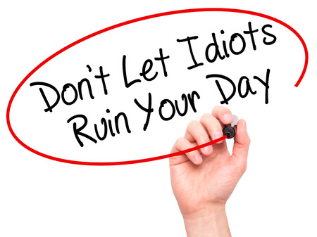 irrelevant: Man Hand writing Dont Let Idiots Ruin Your Day with black marker on visual screen. Isolated on white. Business, technology, internet concept. Stock Photo Stock Photo