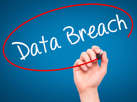 incursion: Man Hand writing Data Breach with black marker on visual screen. Isolated on blue. Business, technology, internet concept. Stock Photo