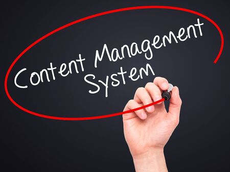 ecm: Man Hand writing Content Management System  with black marker on visual screen. Isolated on black. Business, technology, internet concept. Stock Photo Stock Photo