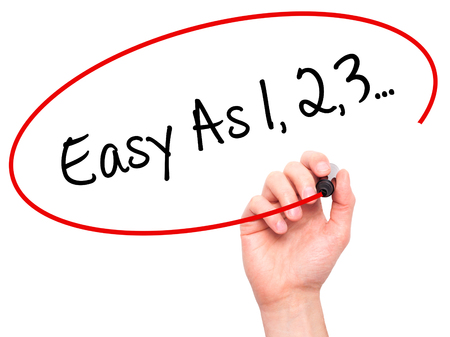 Man Hand writing Easy As 1,2,3... with black marker on visual screen. Isolated on white. Business, technology, internet concept. Stock Photo