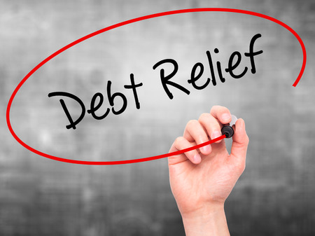 consolidation: Man Hand writing Debt Relief with black marker on visual screen. Isolated on grey. Business, technology, internet concept. Stock Photo Stock Photo