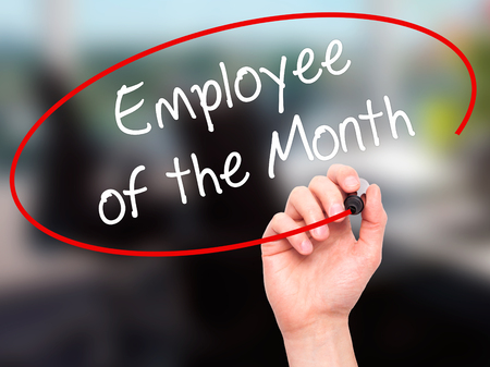 Man Hand writing Employee of the Month  with black marker on visual screen. Isolated on office. Business, technology, internet concept. Stock Photo Stock Photo