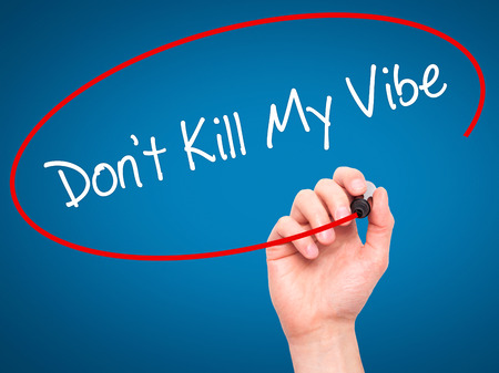 positivism: Man Hand writing Dont Kill My Vibe with black marker on visual screen. Isolated on background. Business, technology, internet concept. Stock Photo Stock Photo