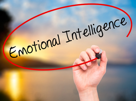 heart intelligence: Man Hand writing Emotional Intelligence with black marker on visual screen. Isolated on nature. Business, technology, internet concept. Stock Photo Stock Photo
