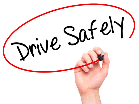 cautionary: Man Hand writing  Drive Safely with black marker on visual screen. Isolated on white. Business, technology, internet concept. Stock Photo Stock Photo